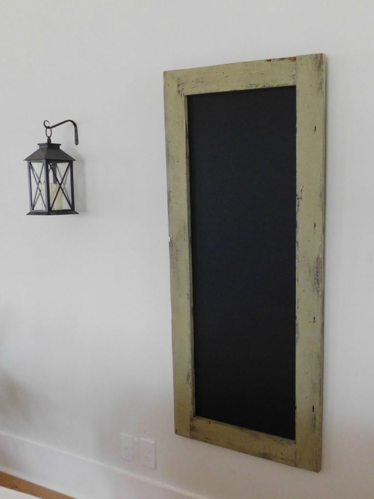 long skinny chalkboard framed menu board
